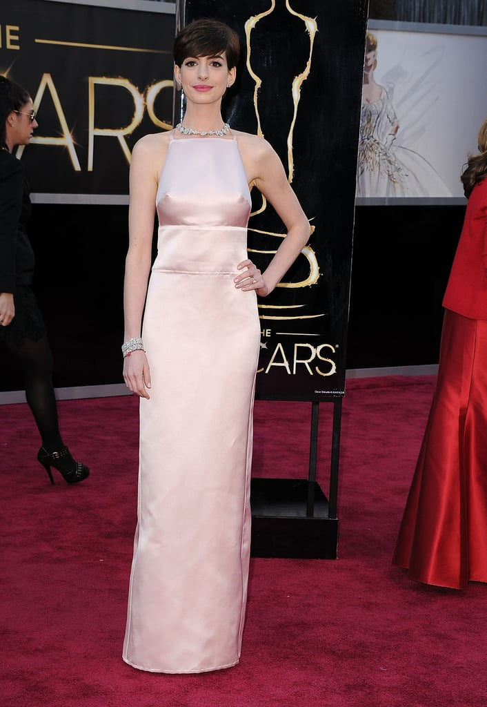 For the 2013 Oscars, Anne worked a pale pink Prada gown — complete with a bow-detailed cutout back — paired with a radiant Tiffany & Co. diamond necklace.