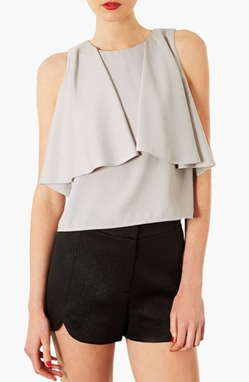 Silky blouses are beautiful, but we love one with a little something special. The draped front on this Topshop pick ($47, originally $70) is gorgeous.