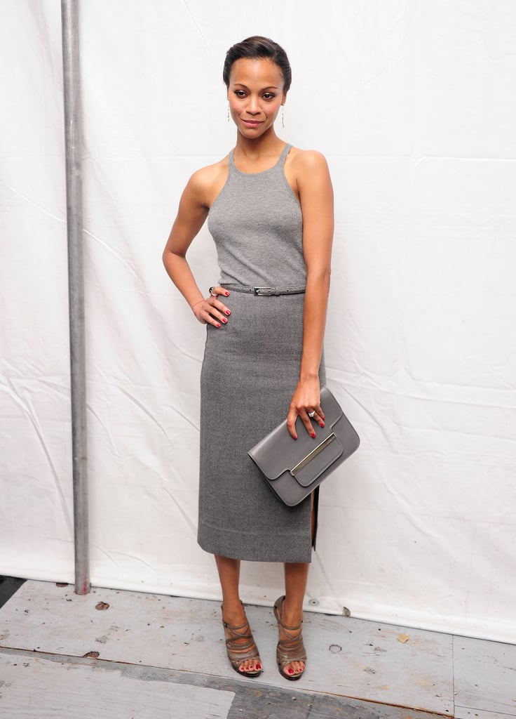 Rocking a sporty-sleek look, Zoe wore a head-to-toe gray Michael Kors ensemble to his Spring '12 runway show.