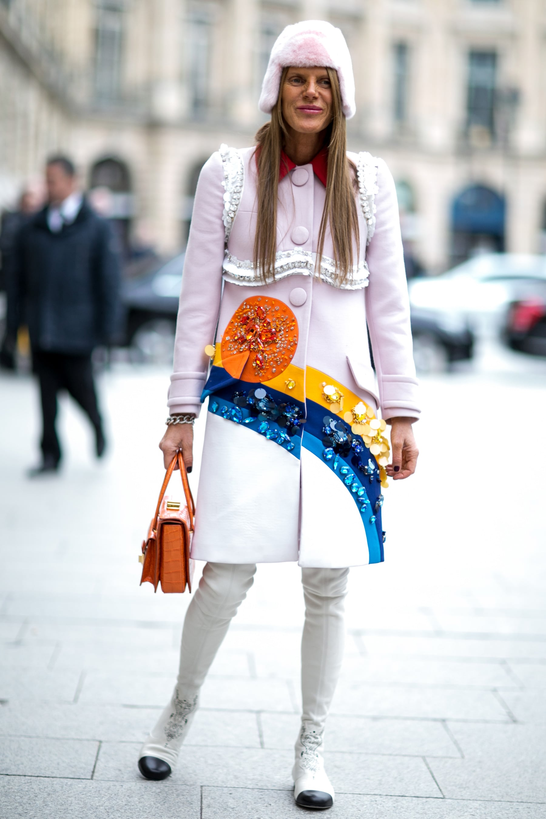 It wouldn't be Anna Dello Russo without some whimsy, this time in the form of a bright coat and Chanel boots.