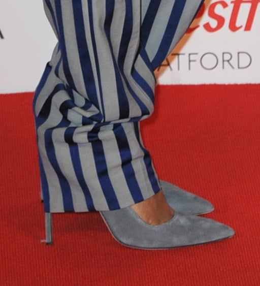 Rihanna tempered her menswear look with gray suede peep-toe pumps.
