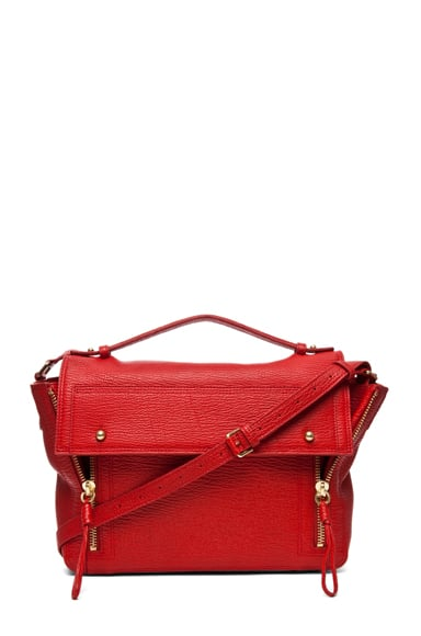 The bag: 3.1 Phillip Lim Pashli Messenger ($750) Why we love it: The bold red had us at hello; from there we took in the easy shape and gold hardware and were quickly lusting after another Lim creation. Think of this as your go-to work bag. In fact, take it anywhere.