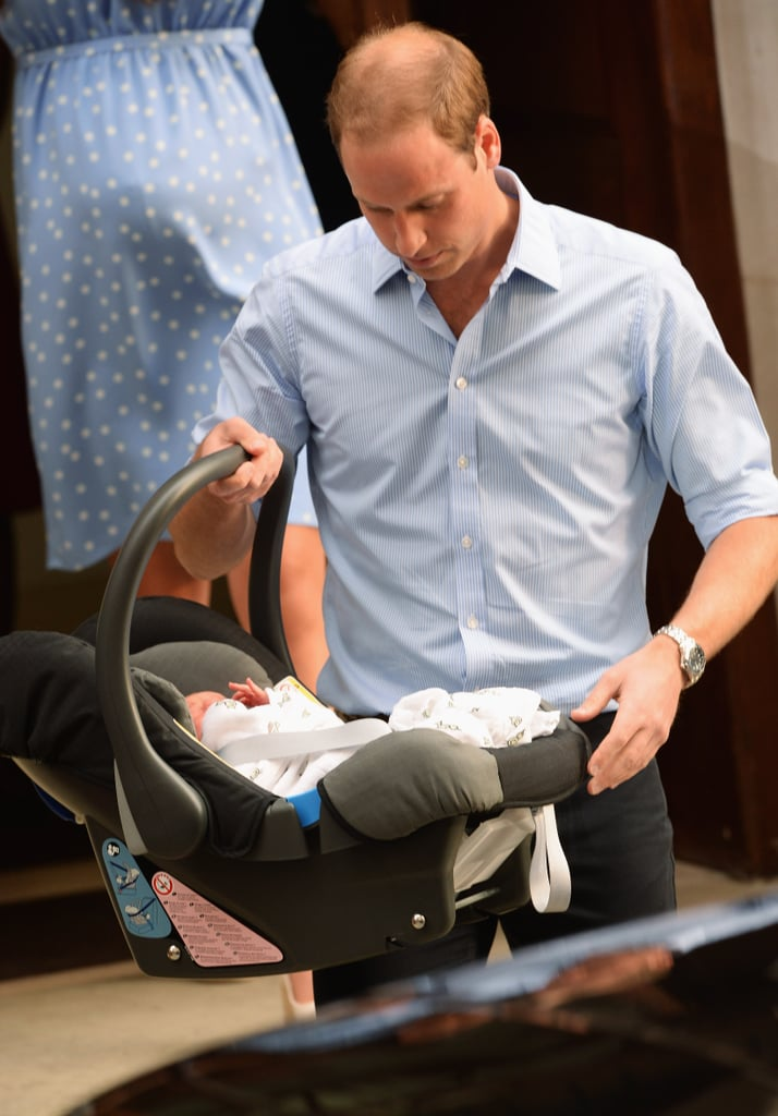 Prince William carried the royal baby in his car seat as they left the hospital.