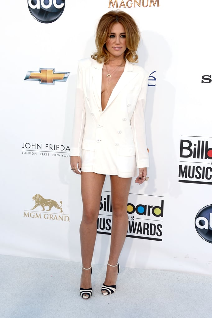 Miley Cyrus showed off her sexy side in a long white blazer at the Billboard Music Awards in Vegas on May 20.