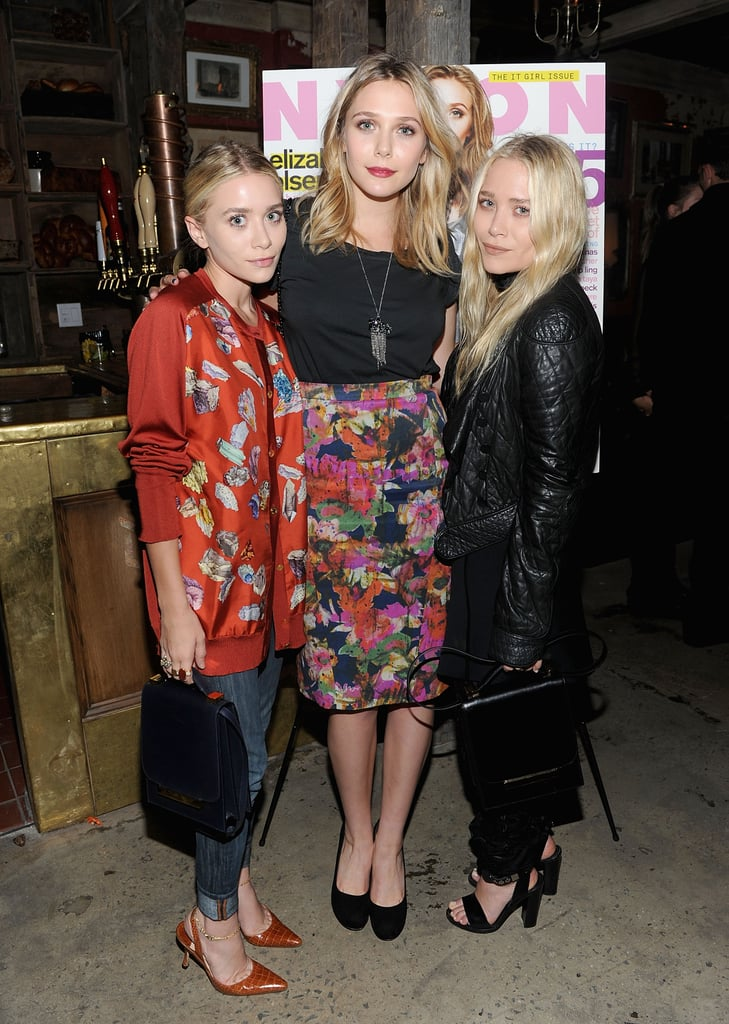 Mary-Kate Olsen and Ashley Olsen came out to celebrate Elizabeth Olsen's cover of Nylon magazine.