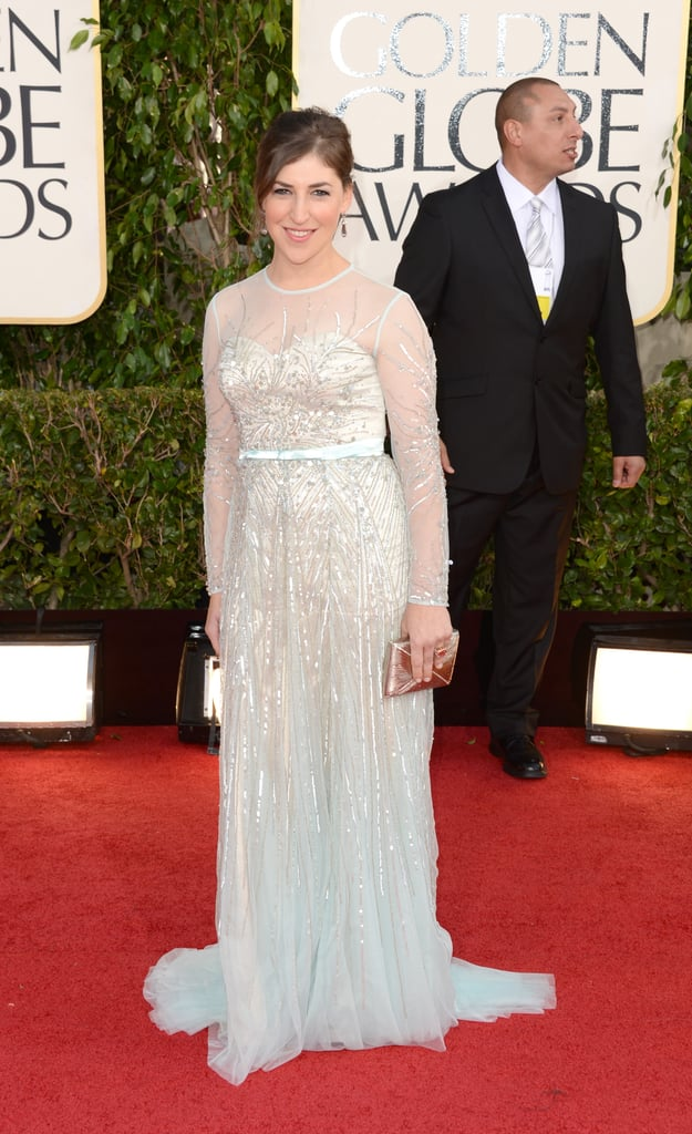 Mayim Bialik —mom to Miles, 7, and Frederick, 4 — covered up in white and silver on the red carpet at the Golden Globes.