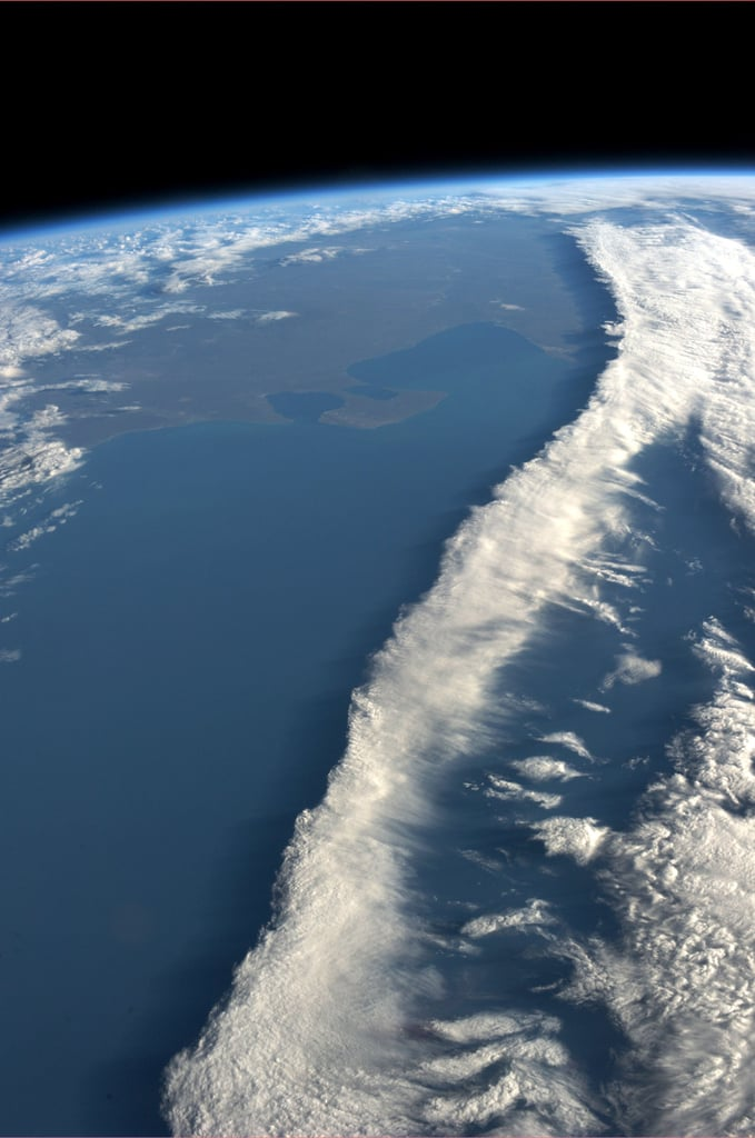 """A ribbon of clouds intersecting the coast of Argentina. Taken August 7, 2013. KN from space."" Source: Pinterest user Karen Nyberg"