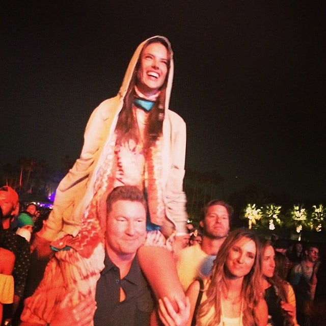 Alessandra Ambrosio watched the music from a friend's shoulders. Source: Instagram user alessandraambrosio