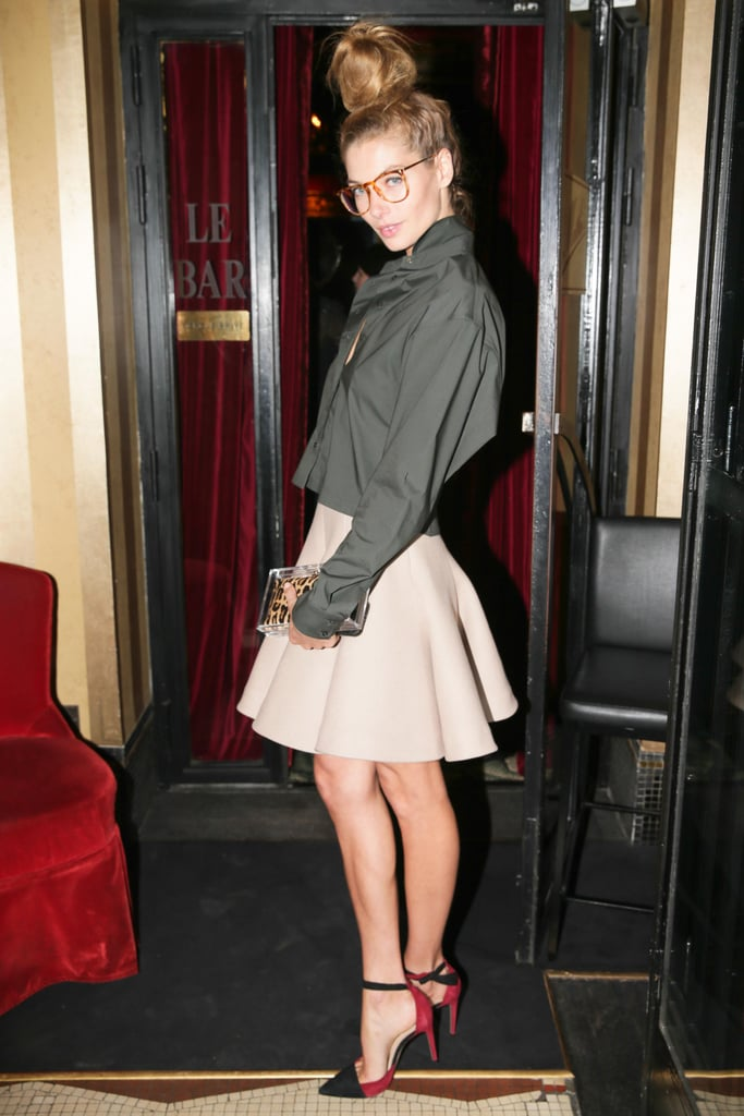 At the Alexandre Birman dinner, Jessica Hart added extra height to her heeled look with an oversize topknot.