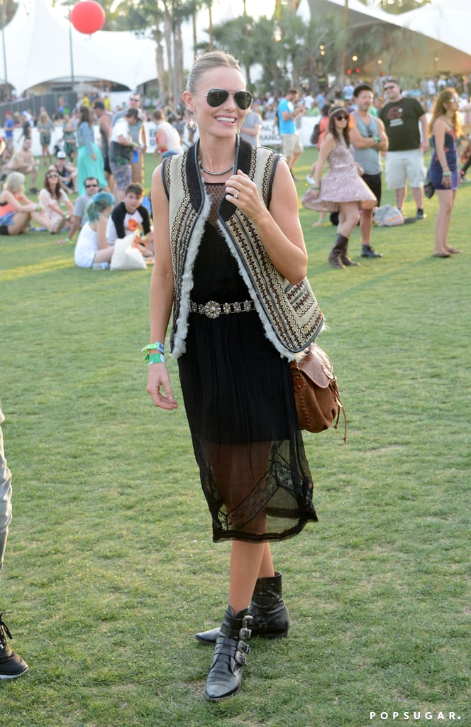 Kate Bosworth strolled the Coachella grounds in a sheer black dress, which she topped with a printed vest and a silver belt.