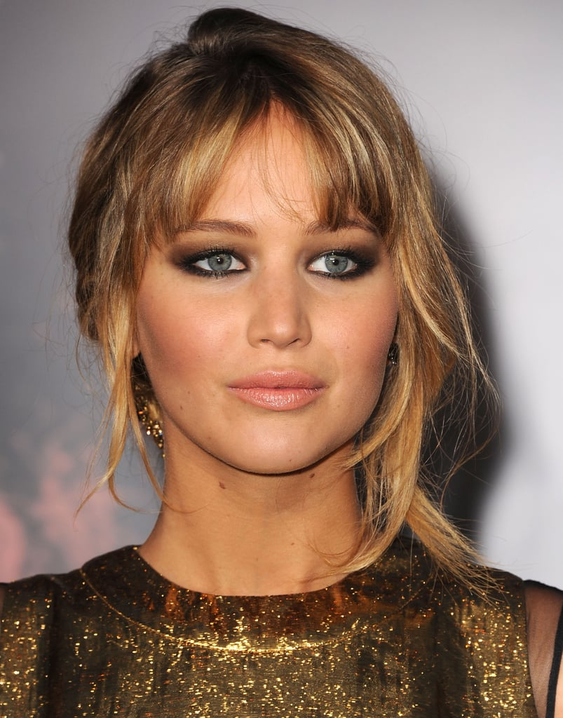 Jennifer Lawrence finished off her look with smokey eyes and a nude lip.