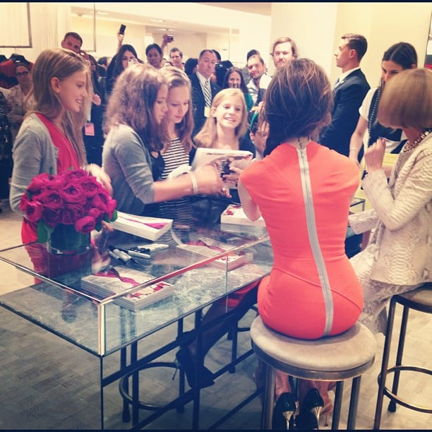 Victoria Beckham wore one of her own designs to meet with fans for FNO.  Source: Instagram user bergdorfs