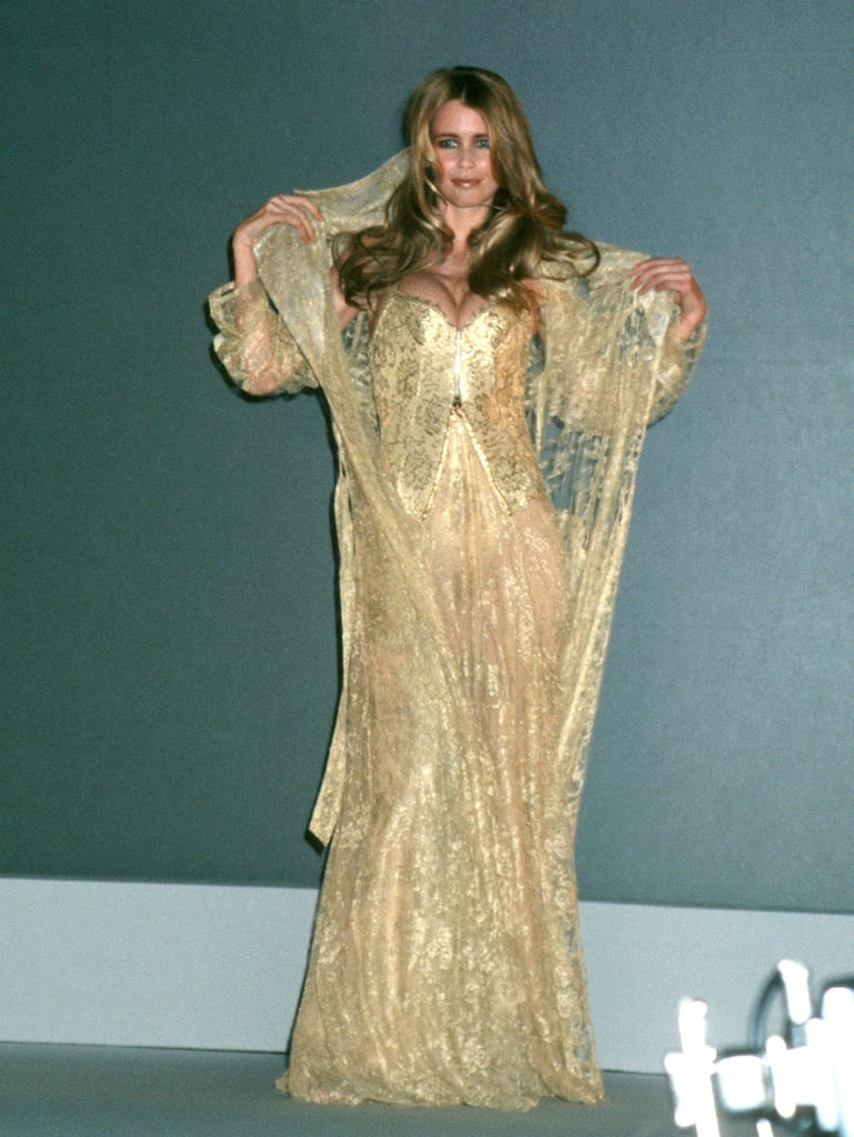 Claudia Schiffer was clad in a gilded robe in 1997.