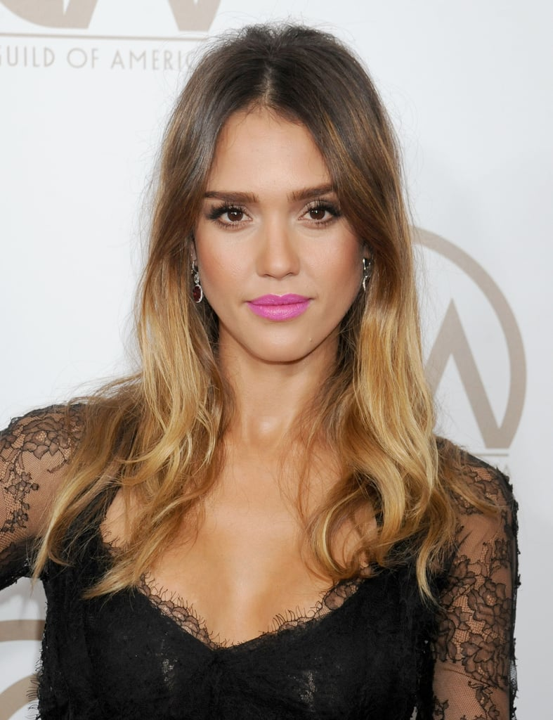 Bright lip colors shine bright against Jessica's golden complexion, as seen at the 2013 Producers Guild Awards, and her tousled waves often inspire envy.
