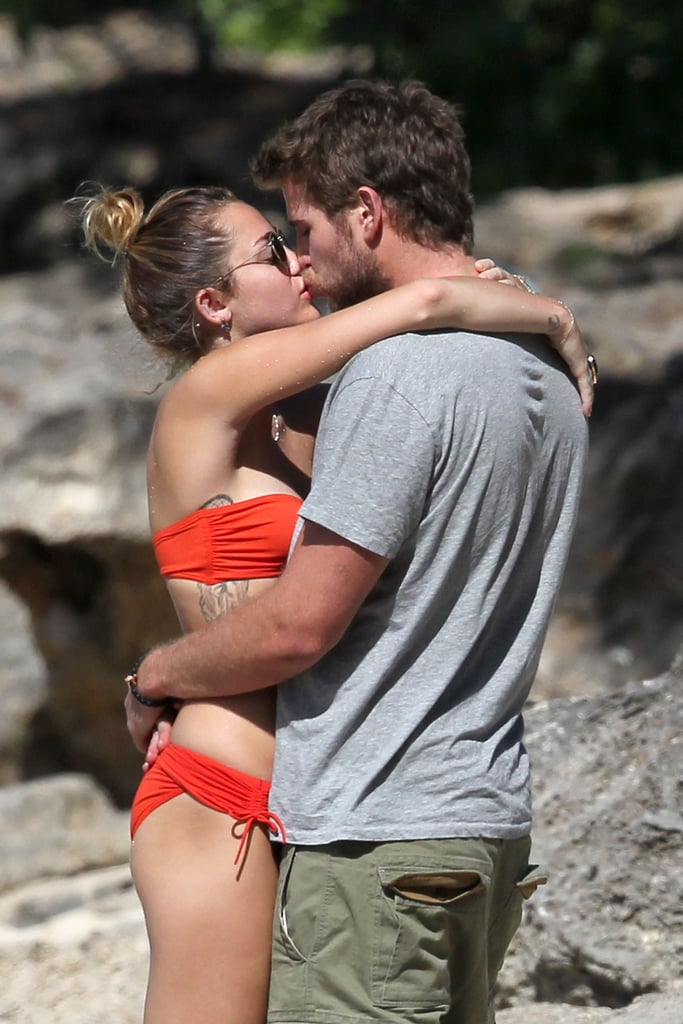 Miley Cyrus and Liam Hemsworth kissed on the beach in Hawaii during a December 2011 vacation.