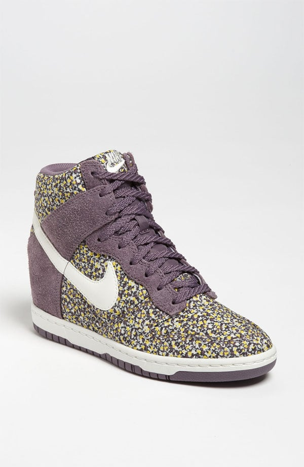 """I recently snagged a black suede pair of Nike wedge sneakers, and I practically live in them. To diversify, but keep it in the""""family,"""" I'm scouting my next pair, this time in a Liberty Floral Print ($135). I'll style them against darker jeans and Fall layers on top, so it's the light offset to everything else. — Marisa Tom, associate editor"""