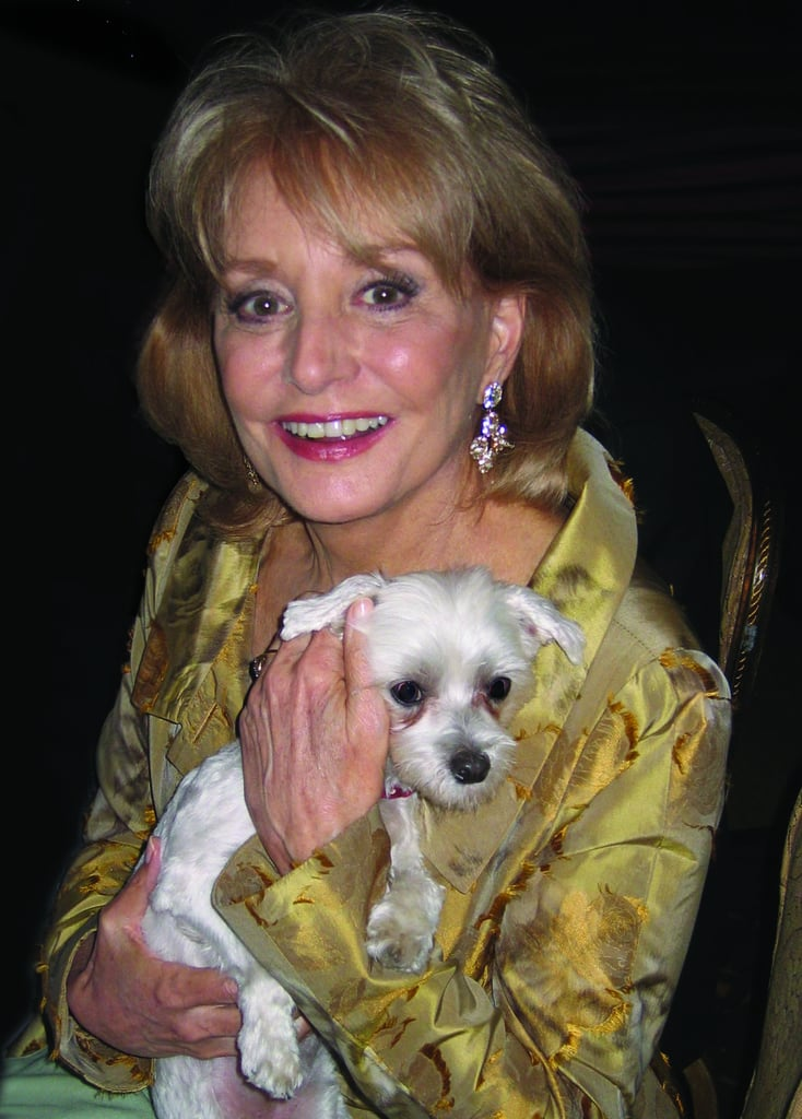 Barbara Walters hugs Lucky tight.