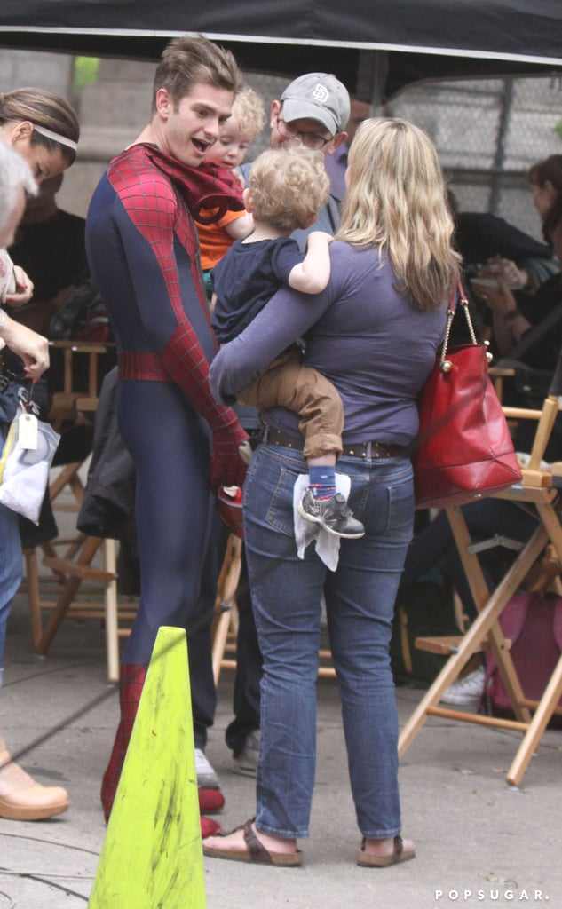 Andrew Garfield took off his mask to greet a young fan on the NYC set.