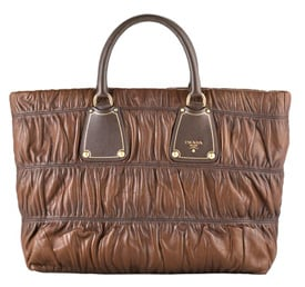 Last Chance To Win a Prada Bag!