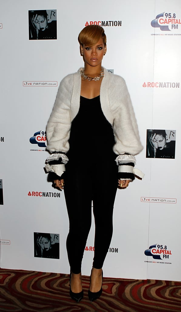 During a 2009 London photocall, Rihanna softened her slick black jumpsuit with a plush Chanel cardigan, featuring over-the-top cuff detailing.