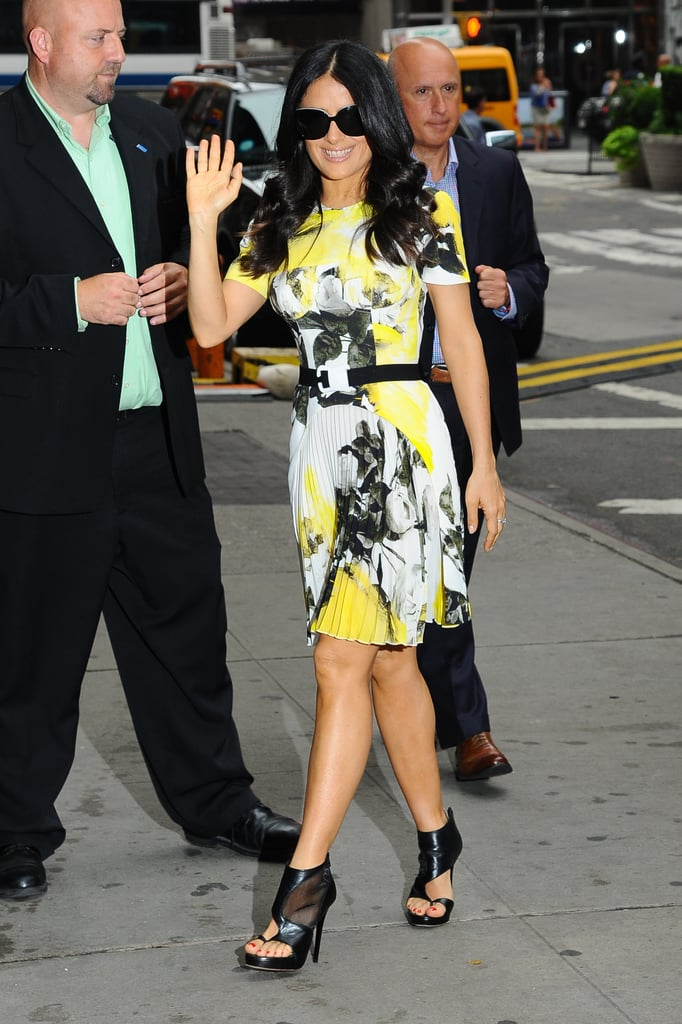Salma Hayek slipped into something considerably brighter on her way into Good Morning America's studios. This time she wore a black, white, and yellow floral Christopher Kane dress and edged it up with black cutout booties.