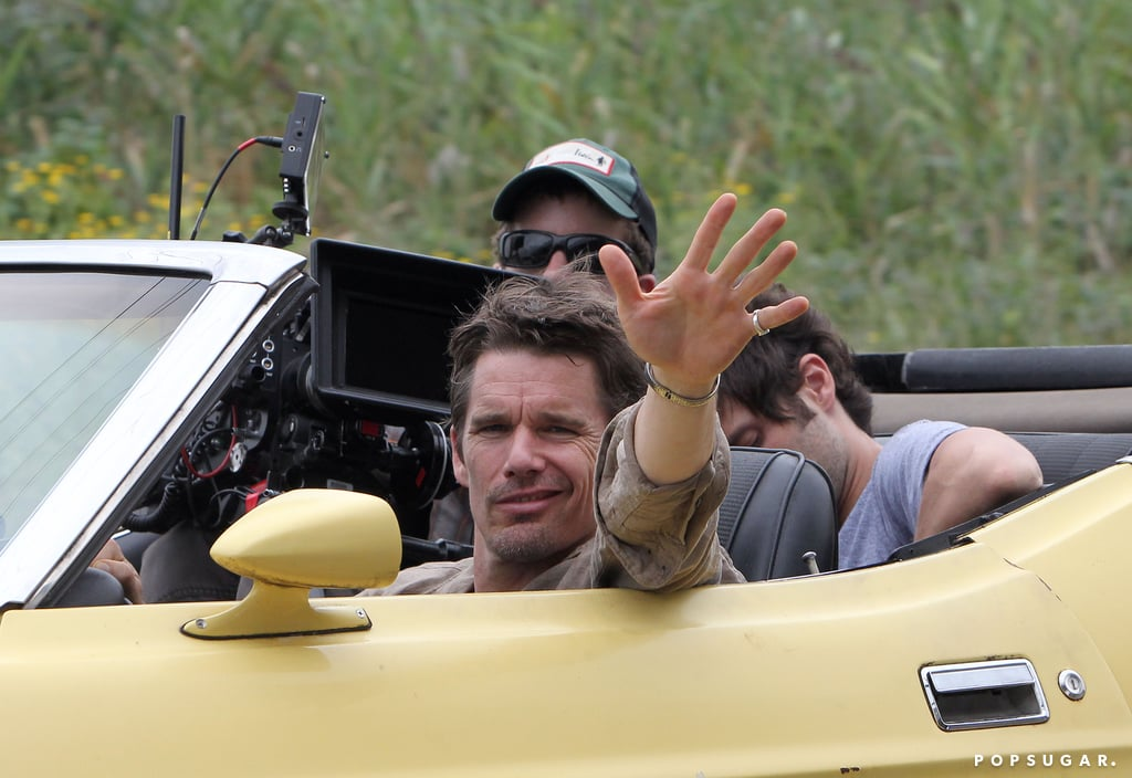Ethan Hawke gave a wave from his canary-yellow car on the NYC set of Cymbeline on Tuesday.
