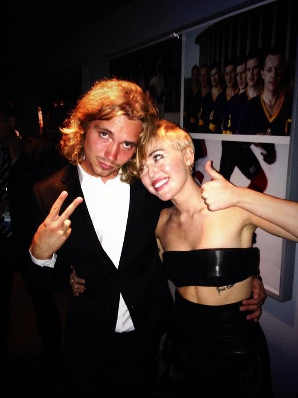 Miley Cyrus got emotional during her pal Jesse's heartfelt speech, but she was all smiles with him backstage.