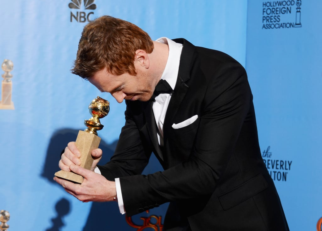 Damian Lewis bowed down to his Globe in the press room.