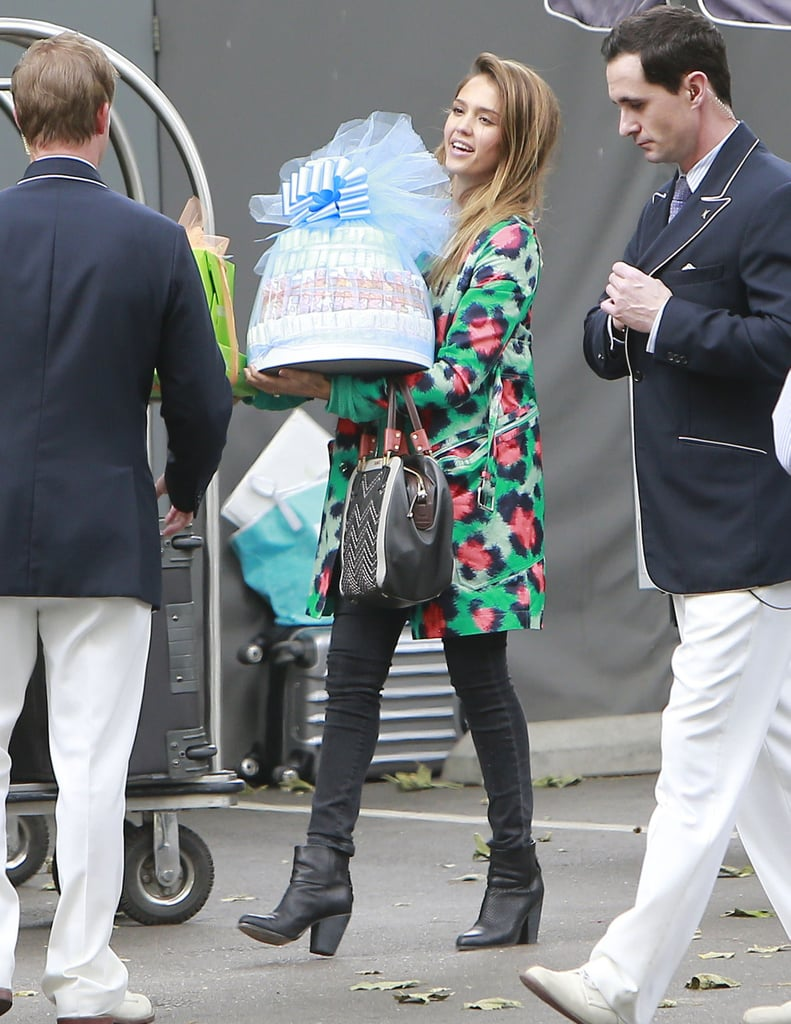 Jessica Alba carried a gift outside of Jessica Simpson's baby shower at the Hotel Bel-Air in Los Angeles.