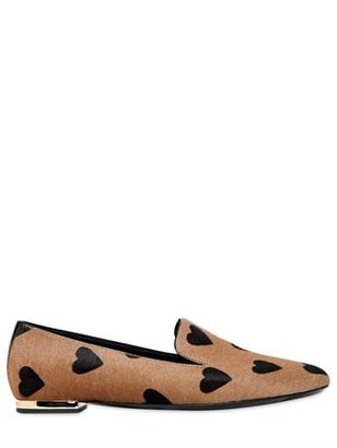 You're about to see Burberry's Fall 2013 runway hearts everywhere — mark my words. They're cute on flats ($495) and not as rough on the wallet as the shirts and dresses. — LM