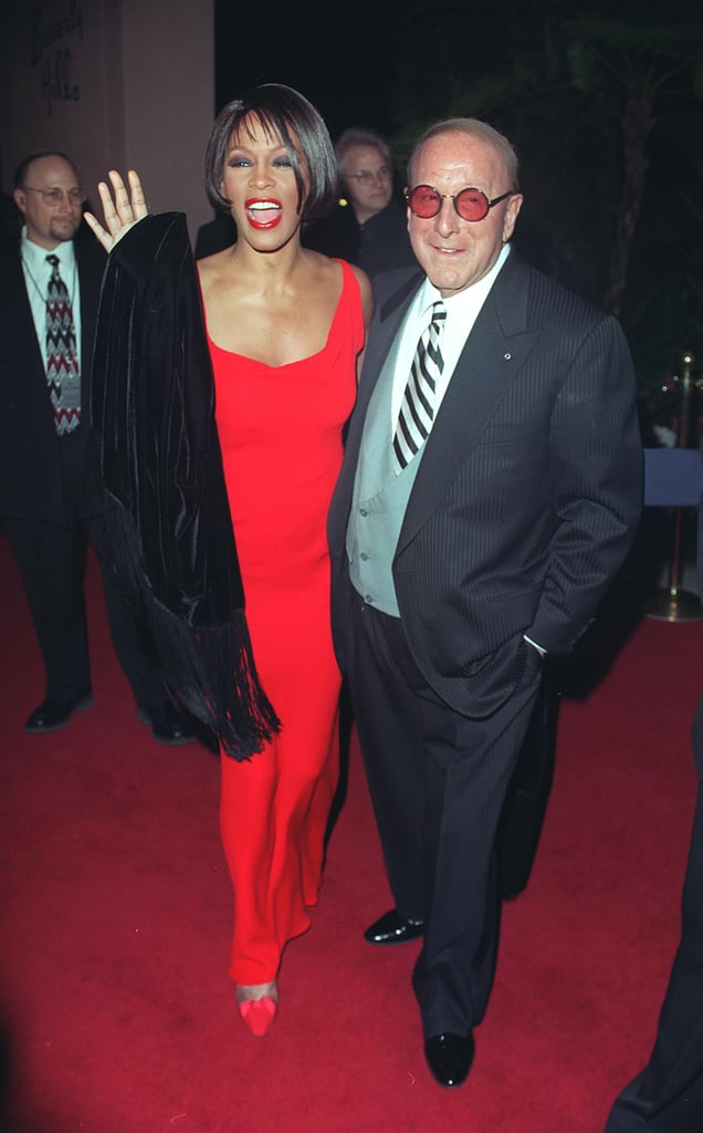 Whitney Houston and Clive Davis posed at Clive's pre-Grammys Party in 1999.