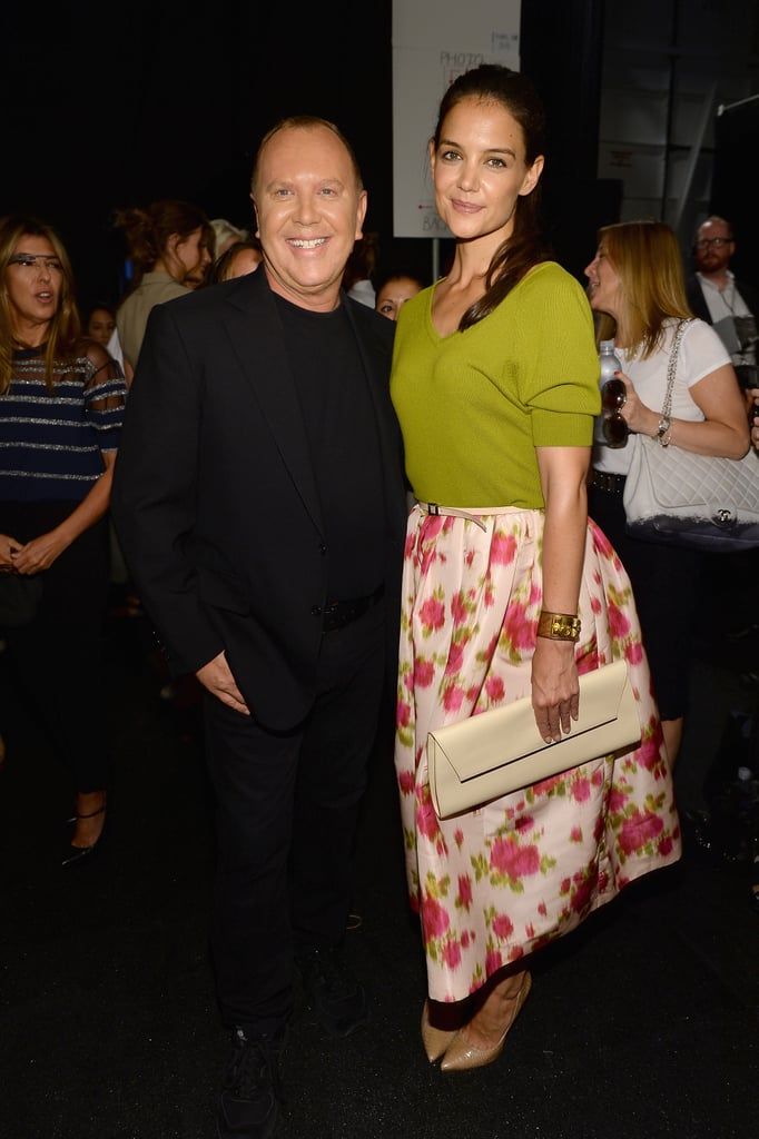 Katie Holmes posed with Michael Kors at his runway show on Wednesday.