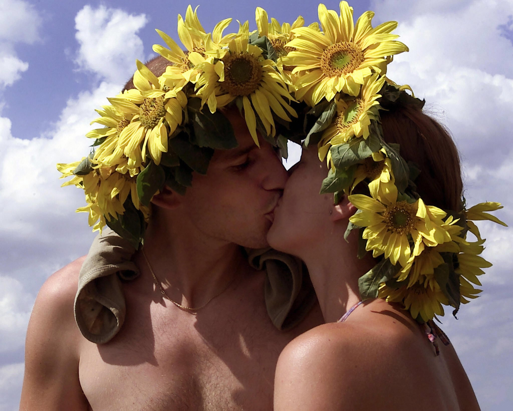 Bloomin' buddies smooched at the Woodstock Stop music festival in Zary, Poland.