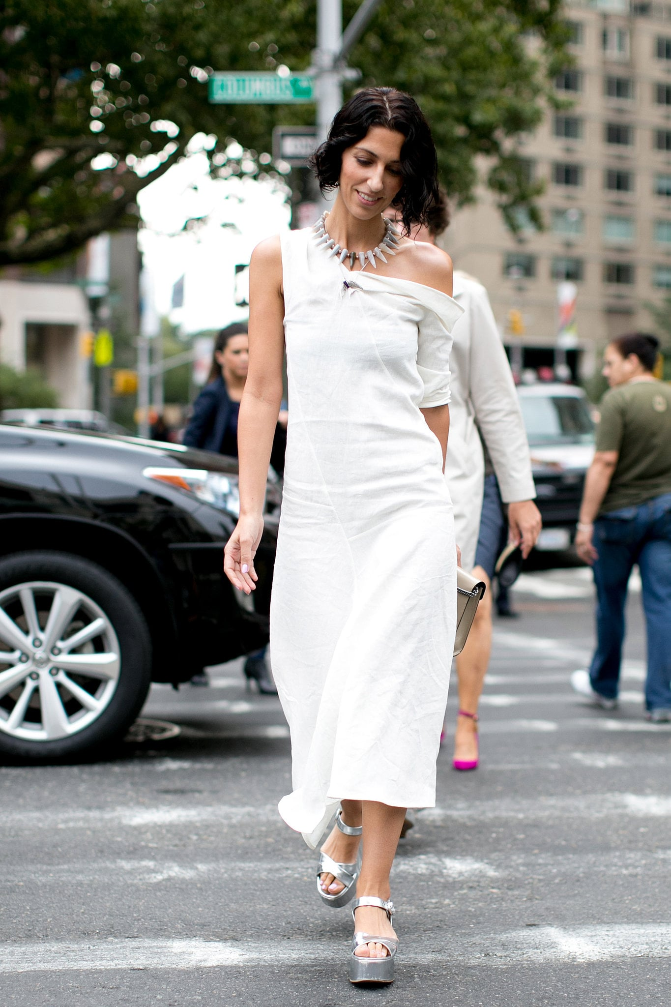 Take Yasmin Sewell's lead and opt for a simple LWD that has a cool cut — then add to the modern, fresh feel with metallic accents.