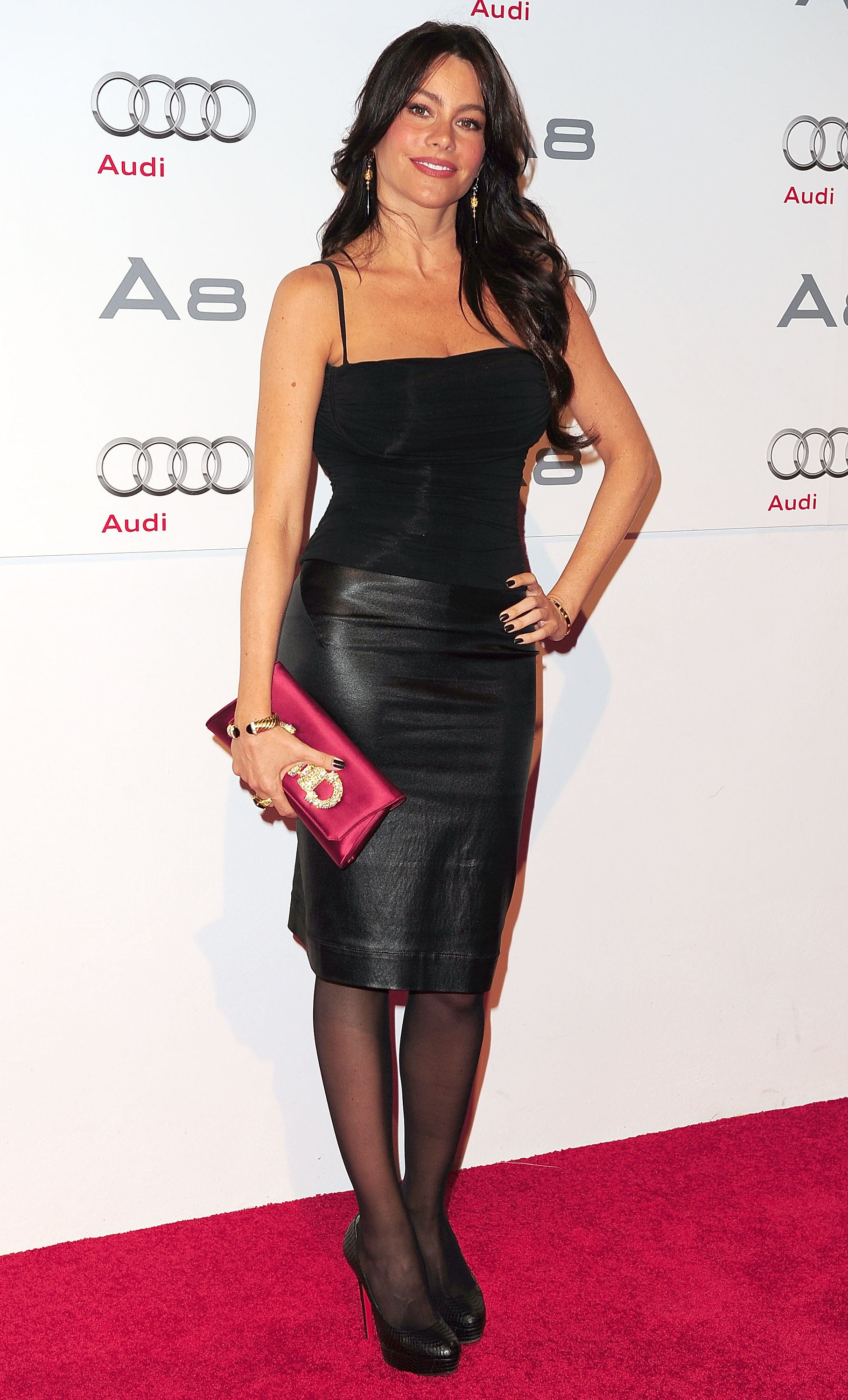 Sofia roughed up her Audi event look with a black leather pencil skirt and coordinating nail polish in November 2010.