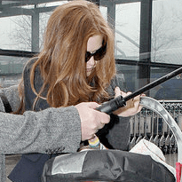 Pictures of Isla Fisher and Her Baby Daughter At Heathrow Airport After UK Rango Photocall