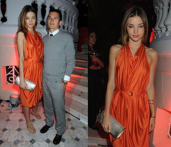 Miranda Kerr and Orlando Bloom Attend Cannes Film Festival, Miranda Wearing a Bright Orange Halter Dress