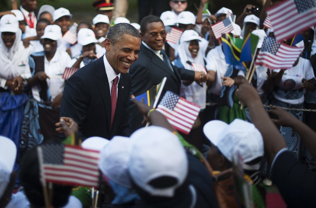 President Obama shook hands with onlookers before a welcoming ceremony in Tanzania in July 2013.