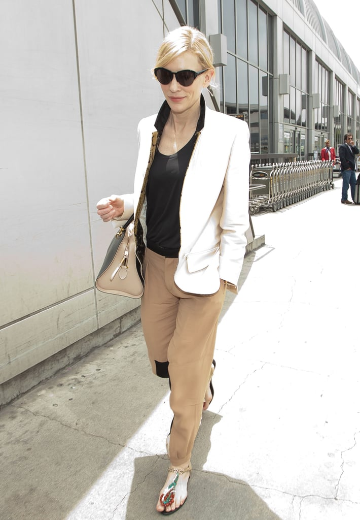 Cate Blanchett arrived at LAX in a chic pairing: a white blazer, tan Chloé trousers, and beaded Roger Vivier sandals.