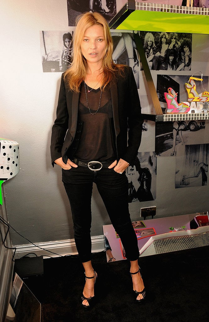 Kate Moss worked her angles like a pro as she posed at the Terry de Havilland store opening in London on April 25.