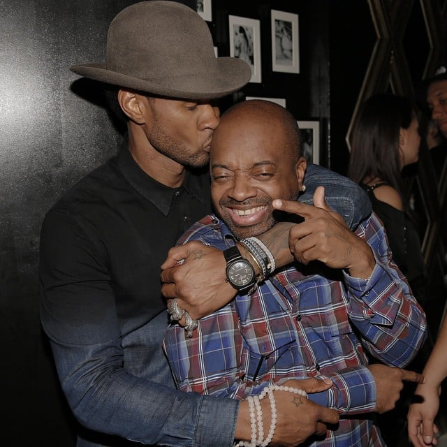 Usher planted a kiss on his mentor, Jermaine Dupree, in this throwback photo from October 2013.