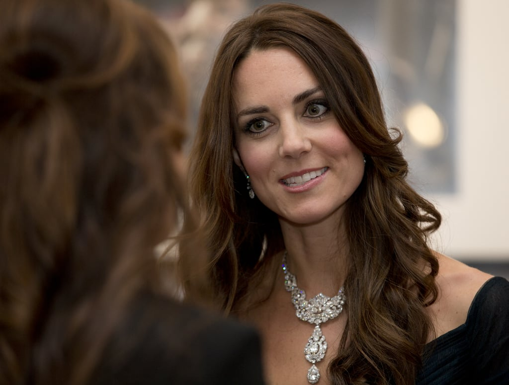 """Kate's New Look It's no secret that Queen Elizabeth II requested that Kate be given a royal makeover leading up to the duke and duchess's trip abroad. The new look will include having Kate sport more royal jewels (mostly borrowed from the queen's personal stash) and longer, weighted hemlines to avoid more """"Marilyn moments"""" like the one Kate experienced when she was visiting Canada.  Unfortunately, the family's trip won't include many formal galas (they aren't really the ball types anyway), so we probably won't see that many tiaras or blinged-out necklaces, but we can expect to see Kate sporting a much more mature, conservative wardrobe. Hopefully, however, this doesn't mean that Kate and William won't be able to slip into some jeans like they did in Canada! The Entourage Kate and William will be taking their largest entourage ever (11 total) for their royal tour. The list includes William's private secretary, Miguel Head; Kate's private secretary, Rebecca Deacon; three press officers, Ed Perkins, Nick Loughran, and Katrina McKeever; an orderly; Kate's hairdresser; the couple's adviser, David Manning; a personal assistant; an extra secretary; and, of course, the nanny. While the entourage may sound large, it's actually pretty small compared to other royal tours, as Prince Charles typically takes along a staff of 14, and the queen regularly travels with several ladies in waiting in addition to the big group of secretaries, press officers, and the like. Want more? Check out our breakdown of the big moments to watch out for in the coming month and a history of royal tours over the years. Source: Getty / Alastair Grant / WPA Pool"""