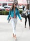 While strutting her svelte stuff through the streets of LA, Alessandra Ambrosio showed off an eclectic pairing: turquoise leather biker jacket with a printed Gypsy05 tank and ripped skinny jeans.