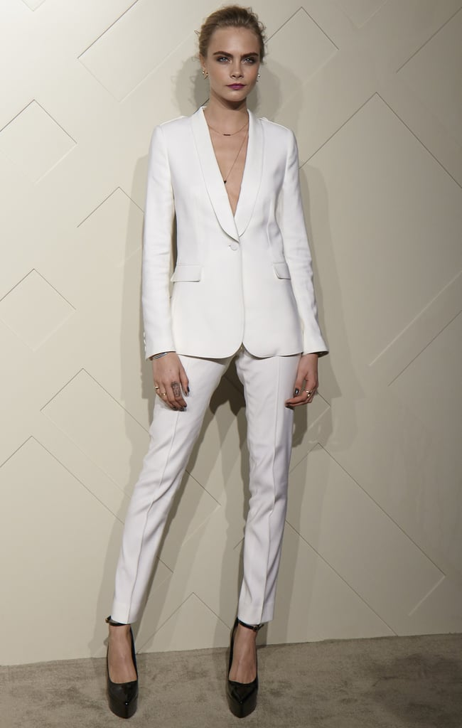 To host a Burberry party in Shanghai, Cara Delevingne picked a slick white suit from the label and black ankle-strap heels. Photo courtesy of Burberry