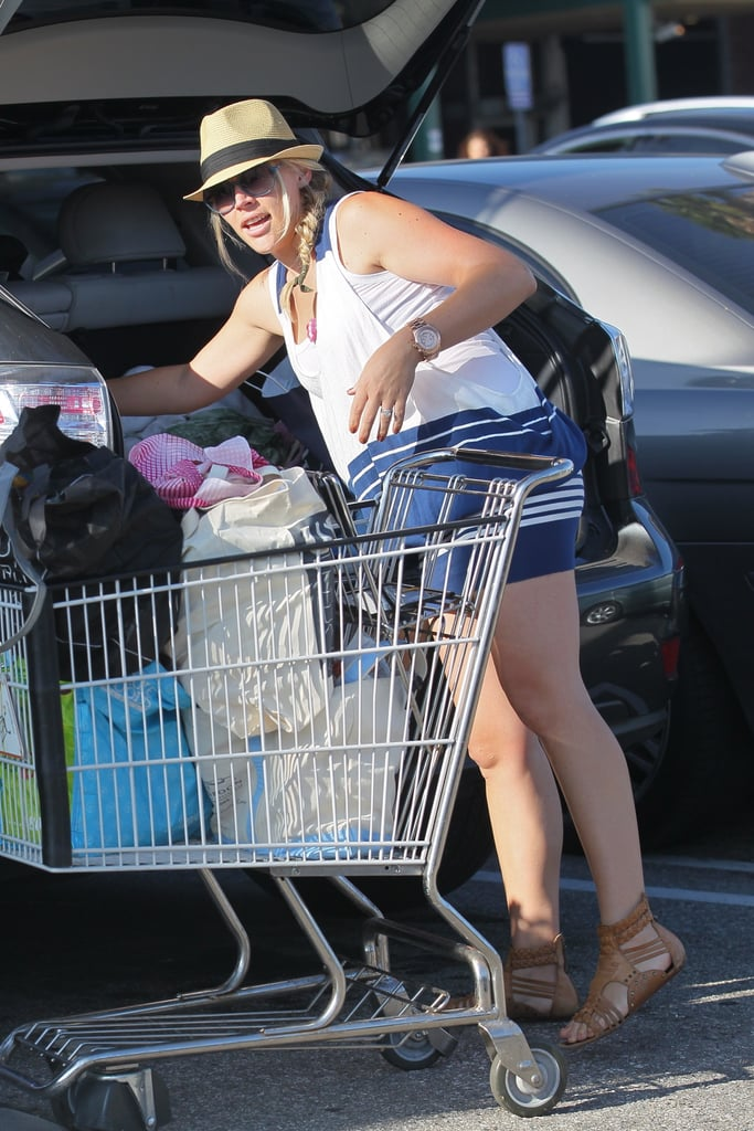 Busy Philipps loaded up her car after shopping at Whole Foods.