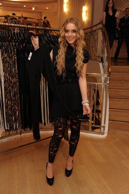 Lindsay Wearing the Star Legging, Holding the Dom Legging