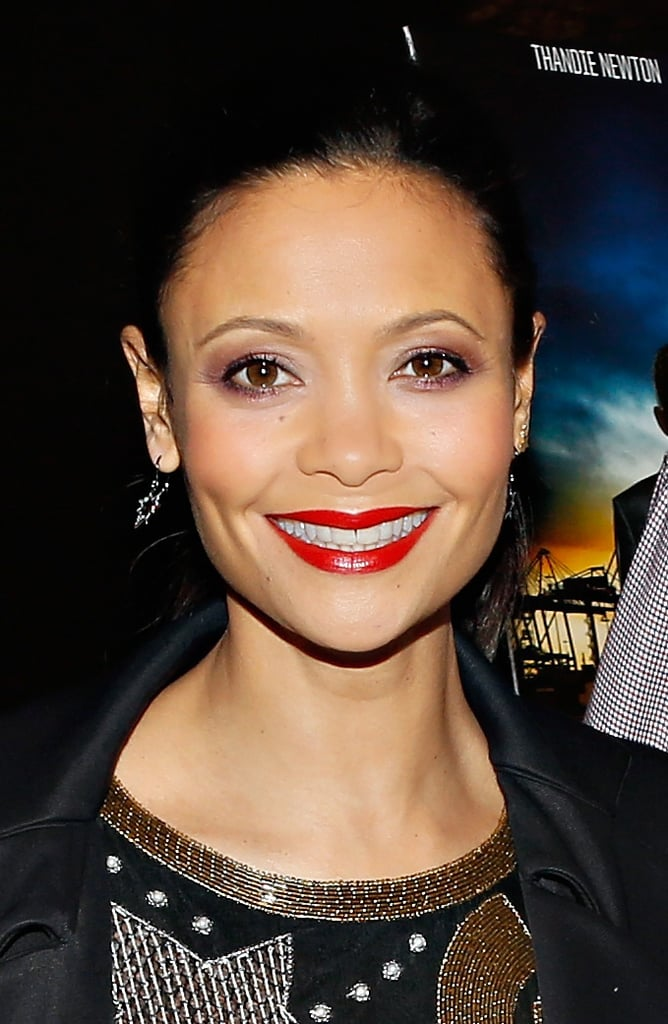 We learned that glossy red lips and shimmering purple shadow can actually go together, as Thandie Newton showcased at the Rogue series premiere in New York City.