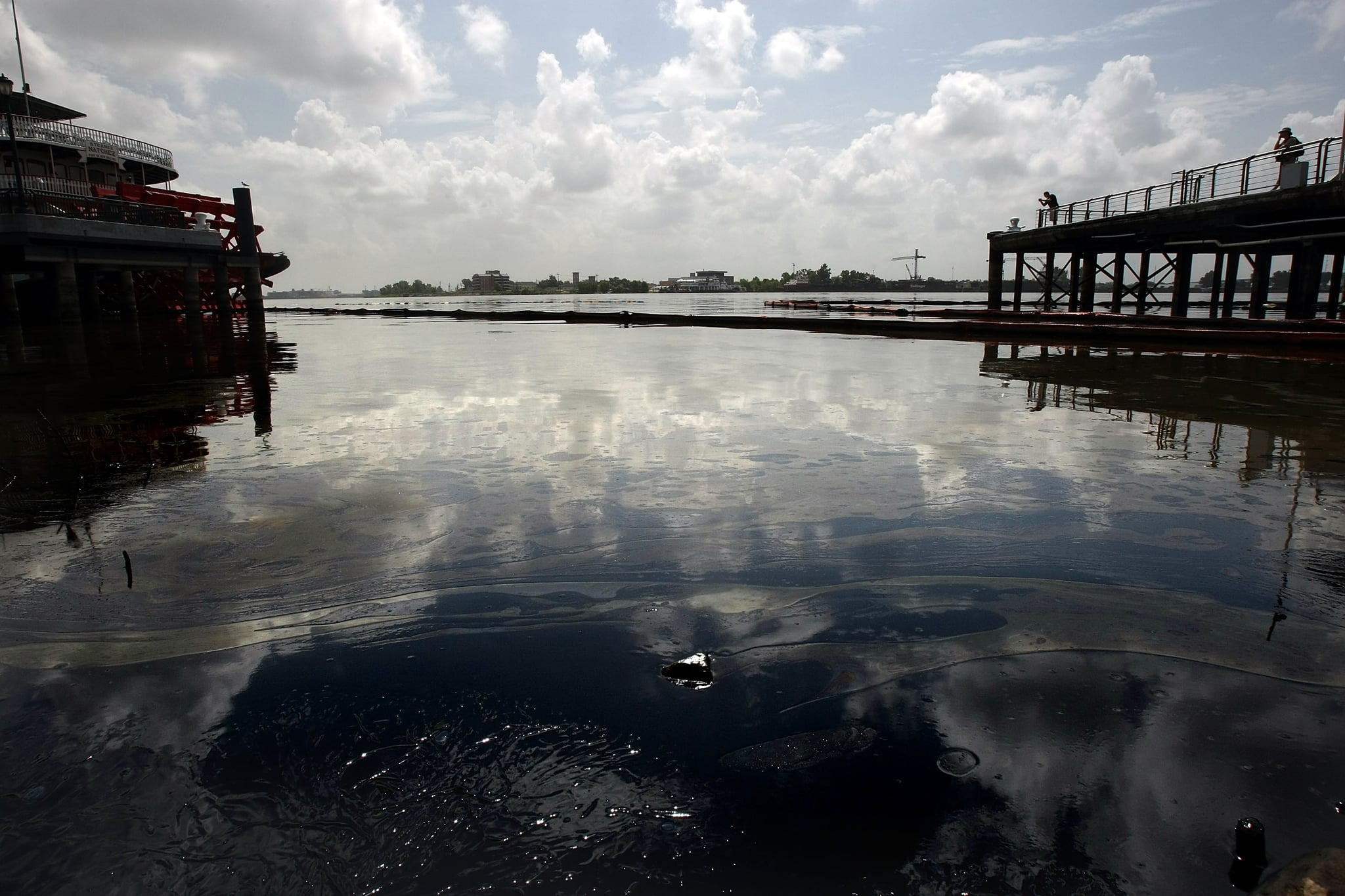 A sheen of fuel oil remains on the Mississippi River following a large spill.