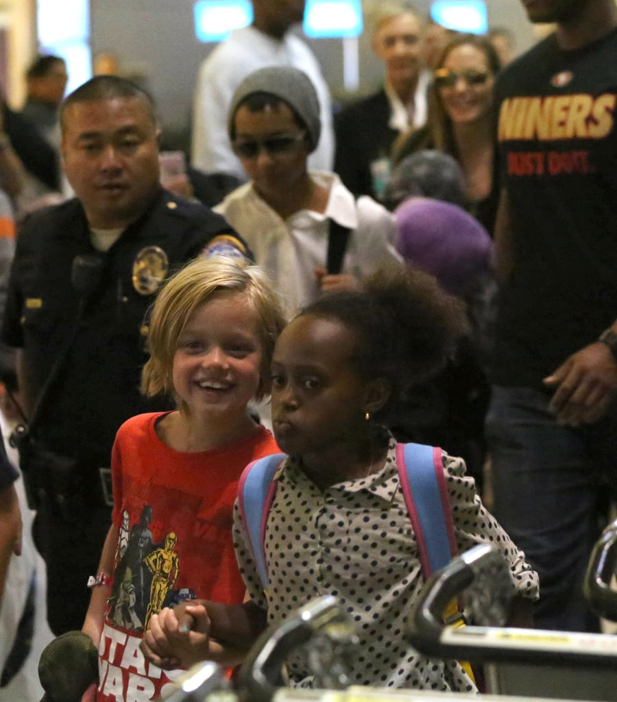 Shiloh Jolie-Pitt and Zahara Jolie-Pitt stayed close to one another in the airport.