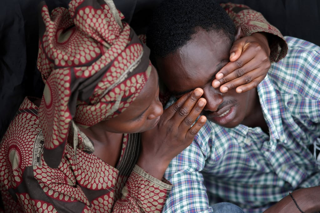 Twenty-two-year-old Bizimana Emmanuel was consoled by a female friend as they commemorated the lives lost at today's ceremony in Kigali.